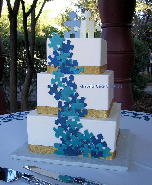 Puzzle Piece Wedding Cake by Graceful Cake Creations.