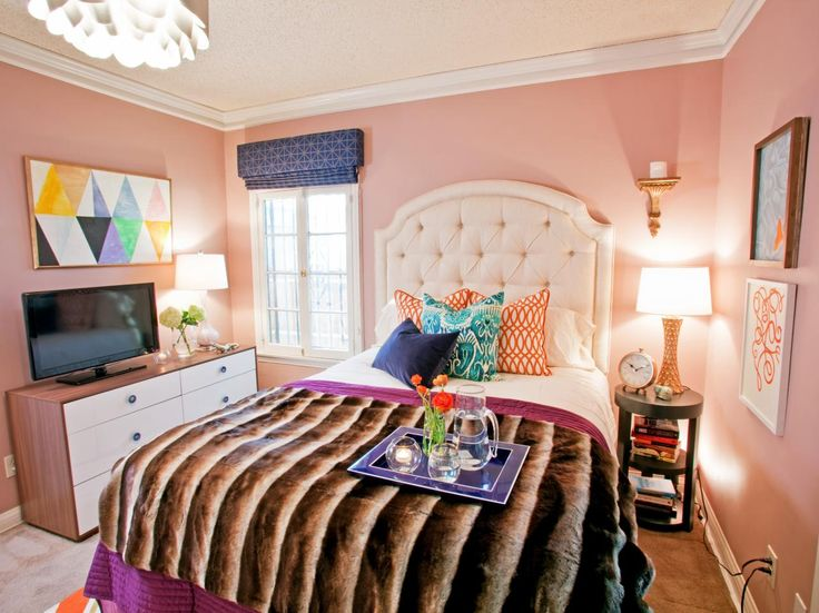 Eclectic and feminine, this sweet pink bedroom by designer Casey Noble mixes fun fabrics, abstract art and soft pastels for a look that exudes a girlish charm.
