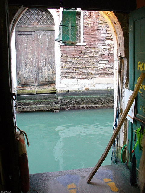 Doors that give straight to the canals of Venice. The Acqua Alta Bookshop