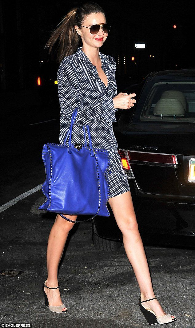 Miranda Kerr wears a black and white shirt dress for dinner out with her husband and son #Heels