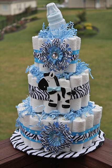 Zebra print and baby blue baby shower diaper cake for Animal print baby shower decoration ideas