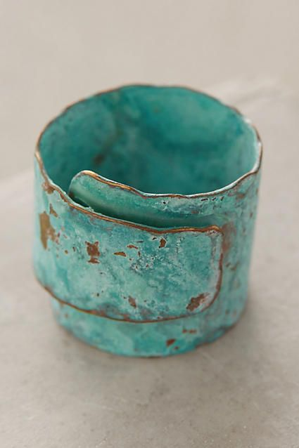 "wrapped turquoise ring. anthropologie. $48.00. oxidized brass. handmade in argentina. 0.75"" w. style no. 39413851."