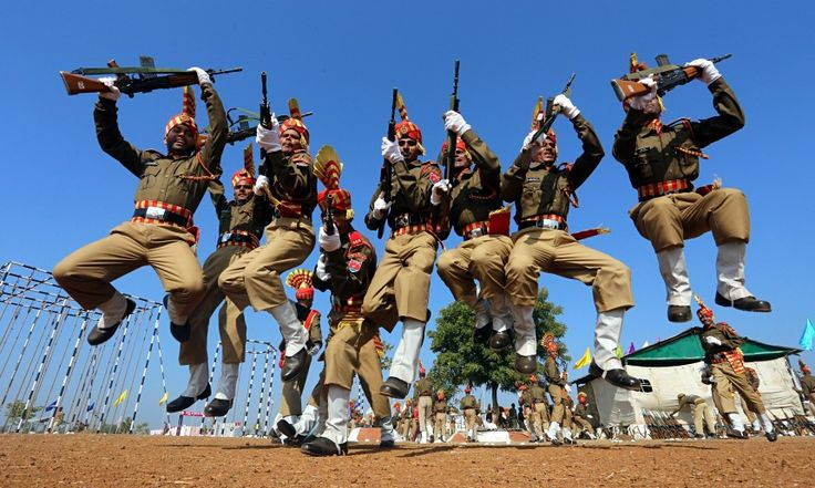 Newly qualified members of India's central armed police, the Sashastra Seema Bal, celebrate after a passing-out parade for 430 cadets from 17 states at the training centre in Bhopal Sanjeev Gupta/EPA.  Eyewitness: Bhopal, India