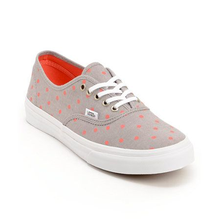 Keep your style classic in the Vans Authentic Slim Grey Chambray polka dot shoes for girls. These Authentics come in an allover Grey Chambray colorway with Neon Coral polka dots throughout and feature timeless low top silhouette with an all canvas upper, an all White vulcanized outsole, micro-waffle bottom tread, and metal eyelets with slim laces for a simplistic style you can wear with anything.
