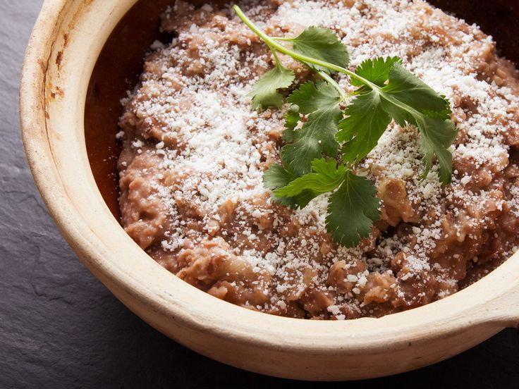 Refried beans are like the mashed potatoes of Mexican and Tex-Mex cooking: they're a versatile, addictive, and delicious side dish. While a relatively simple dish, this master recipe allows you to choose exactly how you want to make them, whether chunky or smooth, cooked with pork fat or vegetable oil, or made with pinto or black beans.