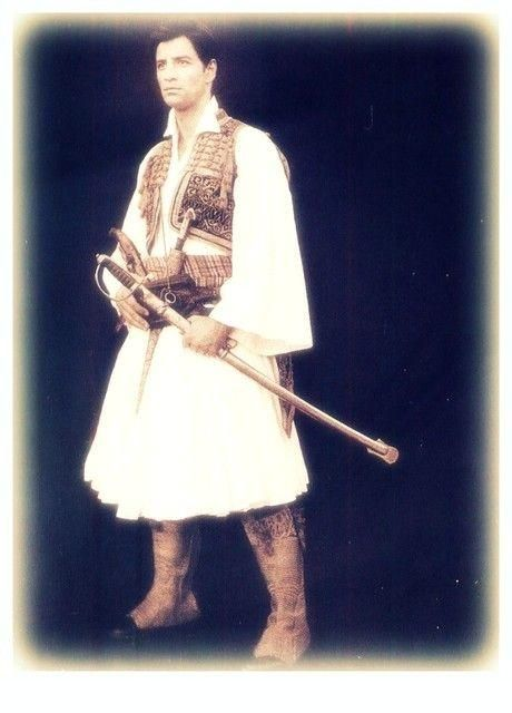Greek popstar , Sakis Rouvas, posing for photographer Kalliopi in a traditional costume. So pretty