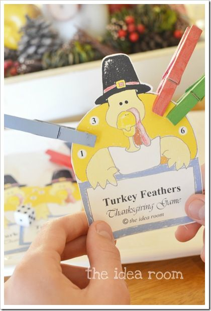 """DIY """"Turkey Feathers."""" An easy Thanksgiving game even the youngest guests can enjoy. Tutorial and printable game card. Each child takes a turn rolling a die and putting a """"feather"""" on the number they just rolled. They keep rolling and adding feathers until they roll a number they already have a feather on, then their turn is over. The first child to get all the feathers on their card is the winner. Get creative and this idea can work anytime you need to keep kids entertained at the dinner…"""
