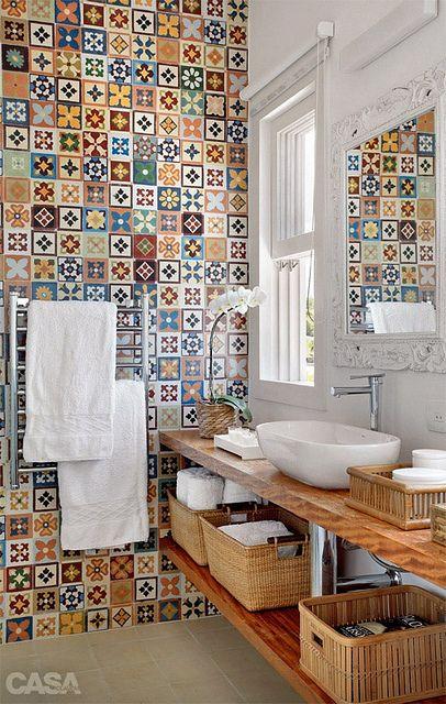 colorful tile wall + white walls + baskets + modern fixtures + white antique mirror