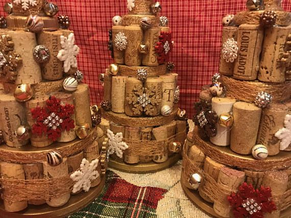 "Handcrafted cork tree Measurements are 17"" around at base and 11"" tall Varied assortment of wine and champagne corks Varied cap tops Varied sizes of white, red, gold and brown snowflakes Assortment of beads including glass beads Gold and silver bells Gold and gold glitter spray paints"