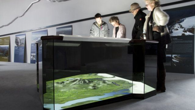"""Interactive Map in Iceland by ART+COM. """"Living Carthography"""" is the central element of the exhibition in the eastern Visitor Centre of the Icelandic Vatnajökul National Park. A dynamic map provides information on the specific flora, fauna and geology of the region, providing visitors with a general overview and orientation."""