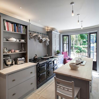 Traditional Kitchen by Russell Taylor Architects -pans hanging above range -dresser unit
