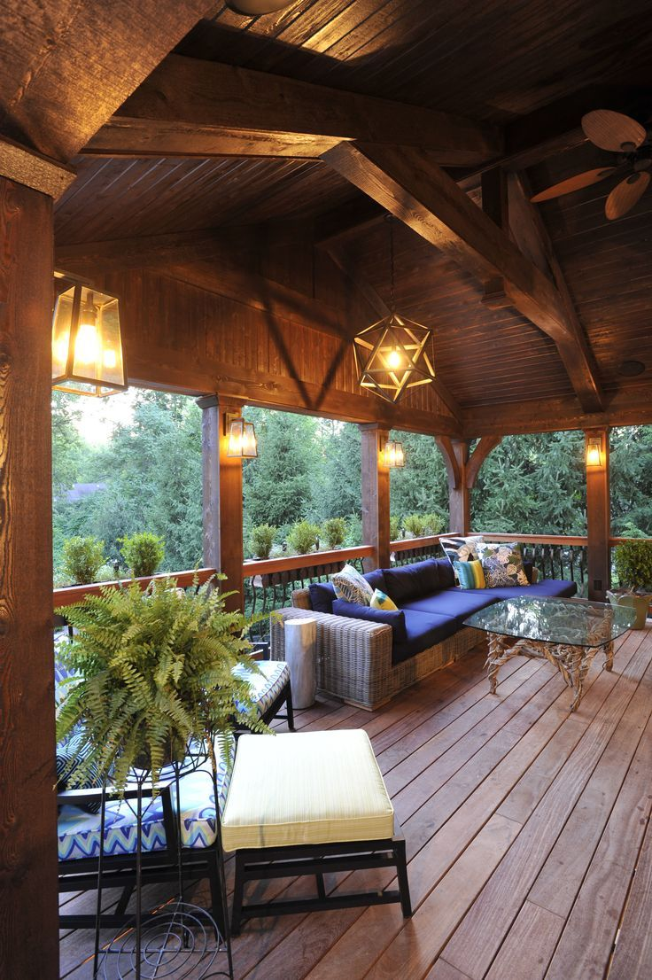 A covered deck becomes an outdoor room with a soaring - Covered outdoor living spaces ...