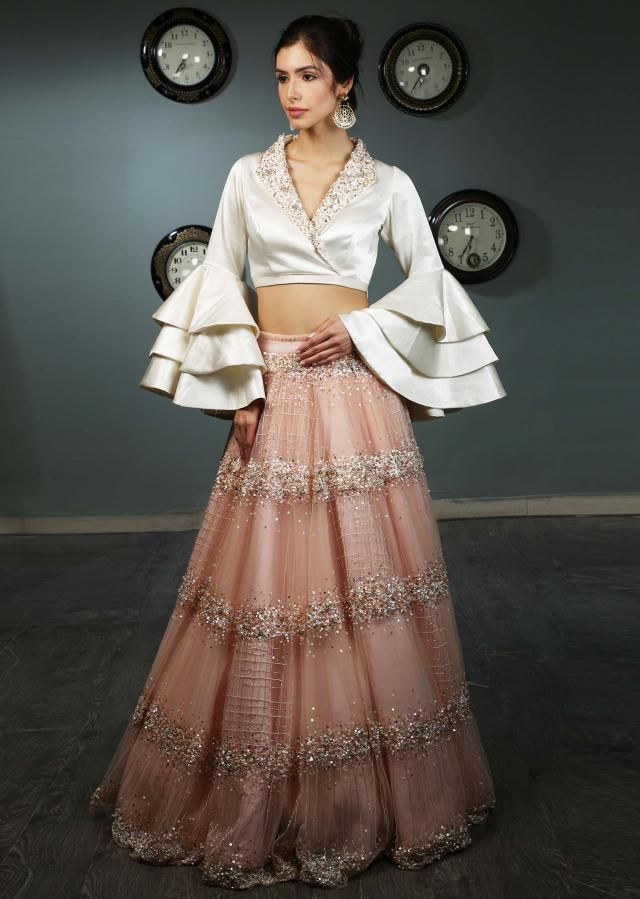 95f4205f9 White satin blouse with layered frill sleeves paired with peach net skirt  in moti and sequins embroidery only on Kalki