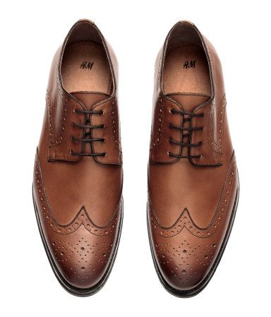 Tawny brown. PREMIUM QUALITY. Leather brogues with open lacing. Leather lining and insoles and rubber soles. Heel height 1 in.