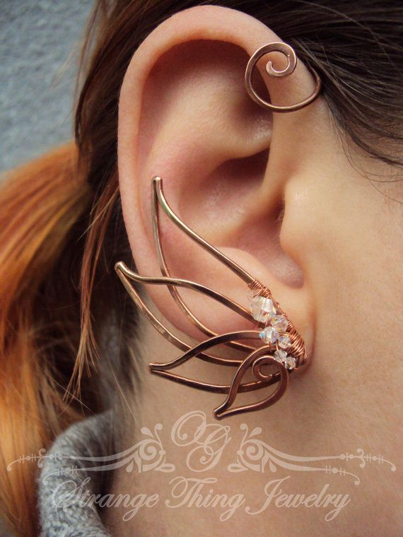 A pair of ear cuffs made of copper wire, glass beads . The piece is covered by metal protecting laquer. No piercing needed. Made for medium