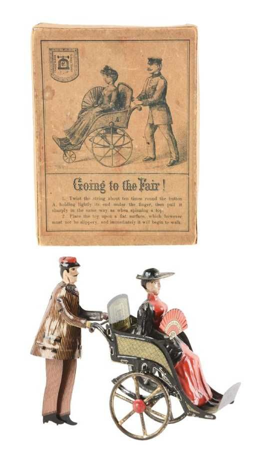 Lot: German Lehmann Going To The Fair in Original Box., Lot Number: 0360, Starting Bid: $750, Auctioneer: Dan Morphy Auctions, Auction: Dec. 16-17 Toy Doll & Figural Cast Iron Day 1, Date: December 16th, 2017 CET