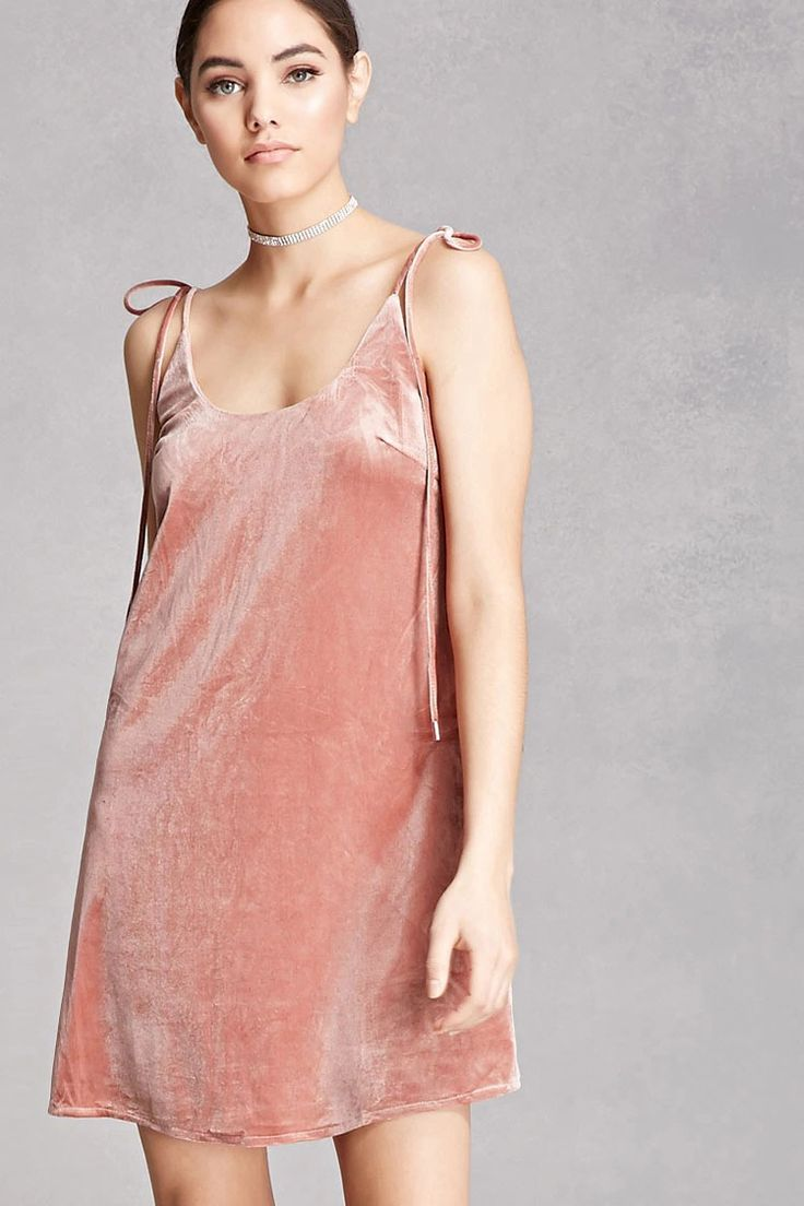 A knit velvet cami dress featuring self-tying straps at the shoulders, a round neckline, and a scooped back. This is an independent brand and not a Forever 21 branded item.