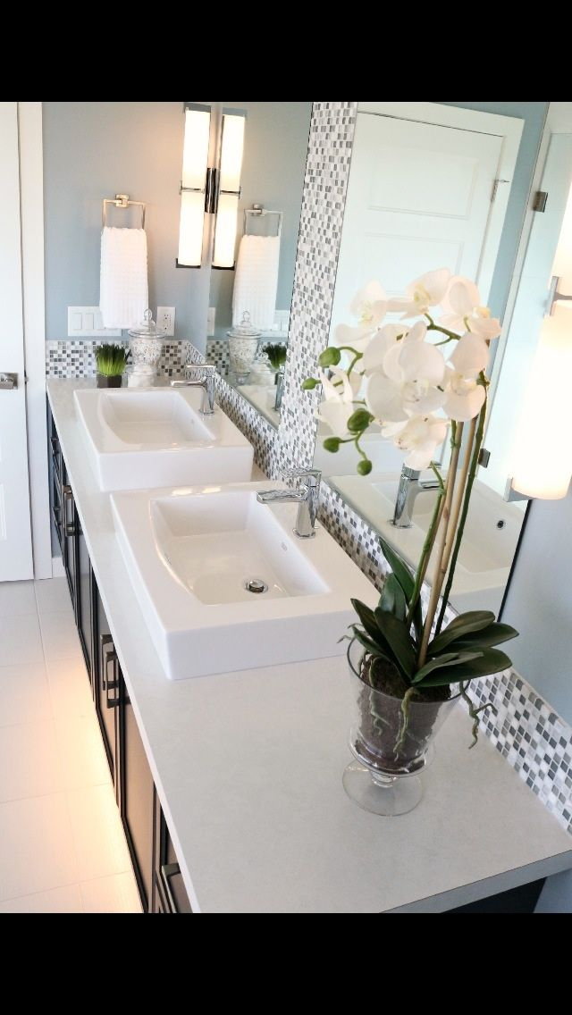 Square box sinks, mosaic tile with full length mirrors. Charcoal cabinet and Luna frost countertop.