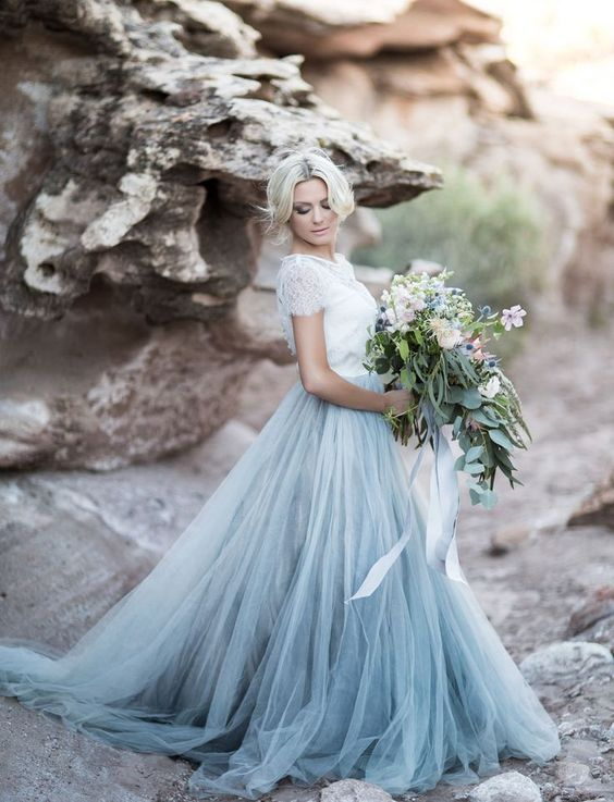 dusty blue skirt with a train and a white lace top