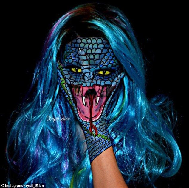 Reptilian:The talented artist creatively uses her hands to complete her…