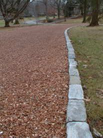 The granite cobblestone edging adds a distinctive look and keeps the chips out of the grass.