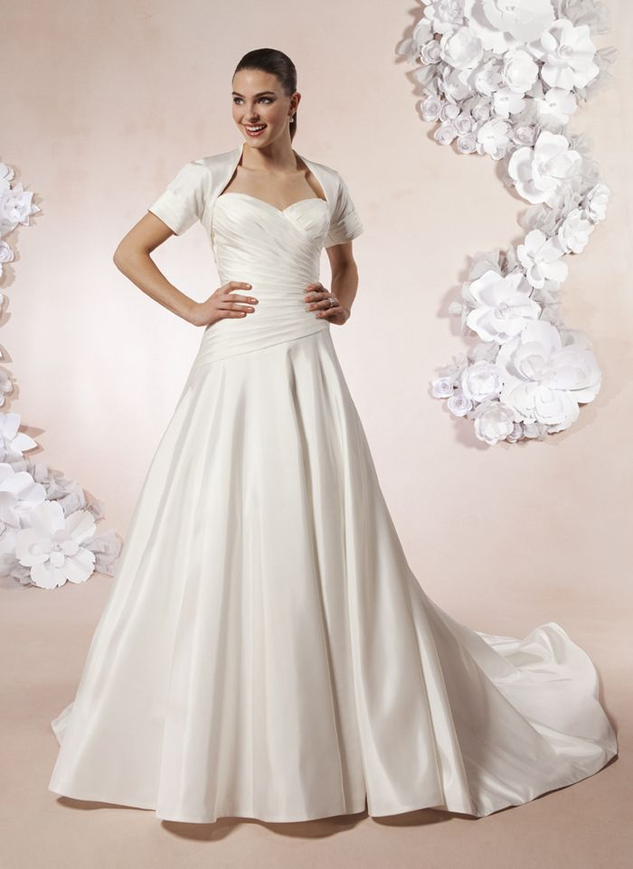 wedding dress hire cape town northern suburbs%0A Sweetheart style      A circular taffeta ball gown with a pleated  sweetheart neckline and an asymmetric