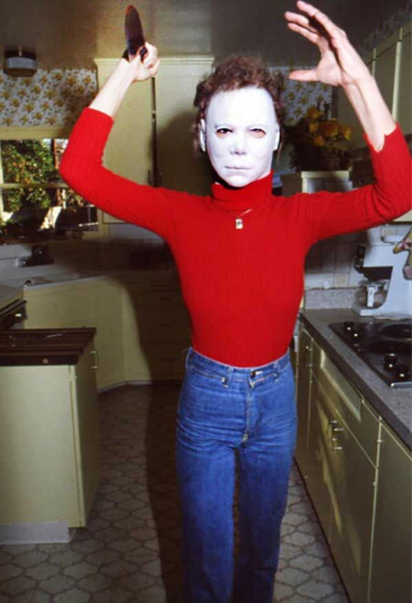 Jamie Lee Curtis wearing the 'The Shape' mask from Halloween, 1979. Photo by Maureen Donaldson.