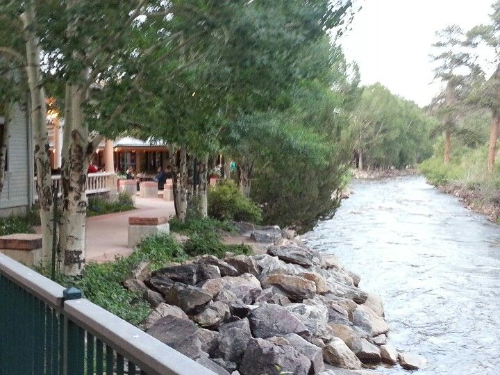 The river walk in downtown Estes Park, CO. In the background is Poppy's and on the left is Mama Rosas.