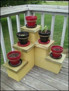 I came up with this idea for a low cost plant stand... 3  8x16 cement blocks and 3  8x8 blocks and a 2x10 pressure treated board cut to size. Going to stain the wood a dark brown sometime soon.