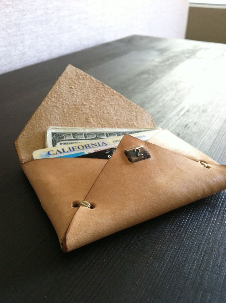 Genuine vegetable tanned leather envelope card bill holder with 1930's vintage/antique copper number plate. $40.00 USD, via Etsy.