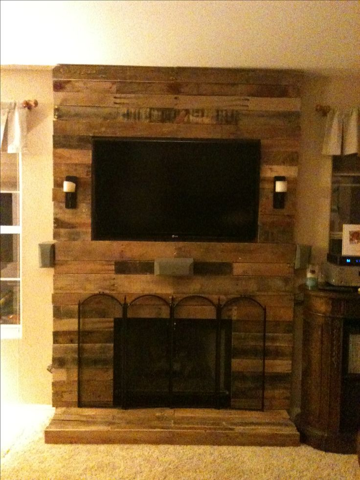Pallet fireplace surround made with pallet wood and 2x4 framing.