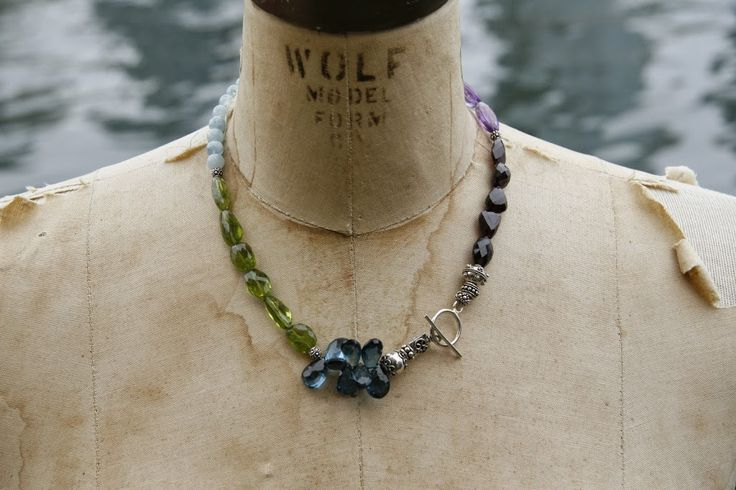A mix of gems including London blue topaz, peridot, garnets, aquamarines, and amethysts.