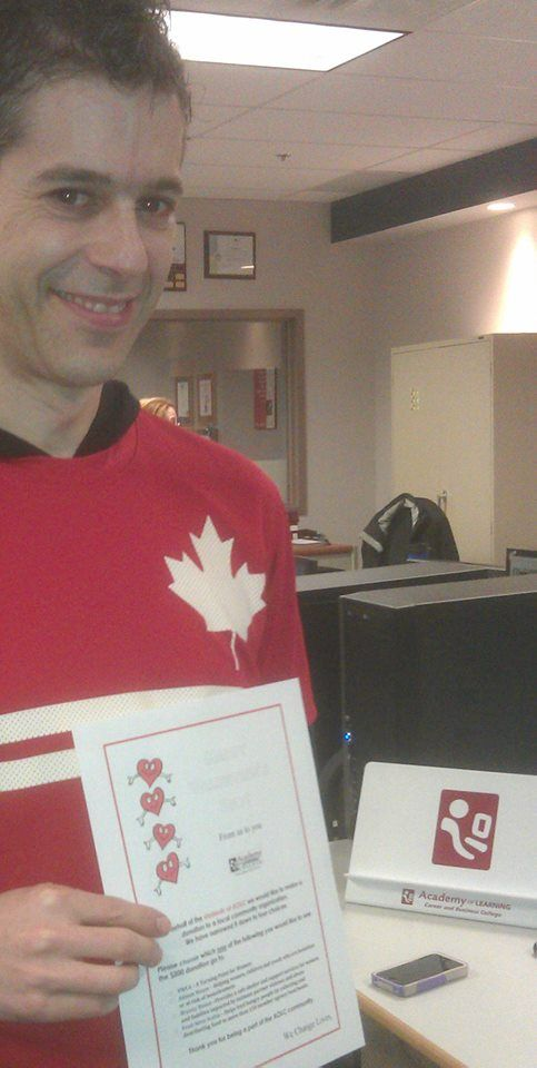 Duane Yeomans from the Dartmouth and Halifax Campuses dressed in the spirit of Valentine's Day, Canada's Olympic Athletes, and Canadian Tennis all in one.