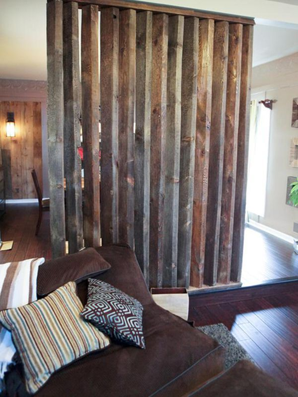 Wooden room divider with a rustic, aged look that separates the living and dining rooms  DIY