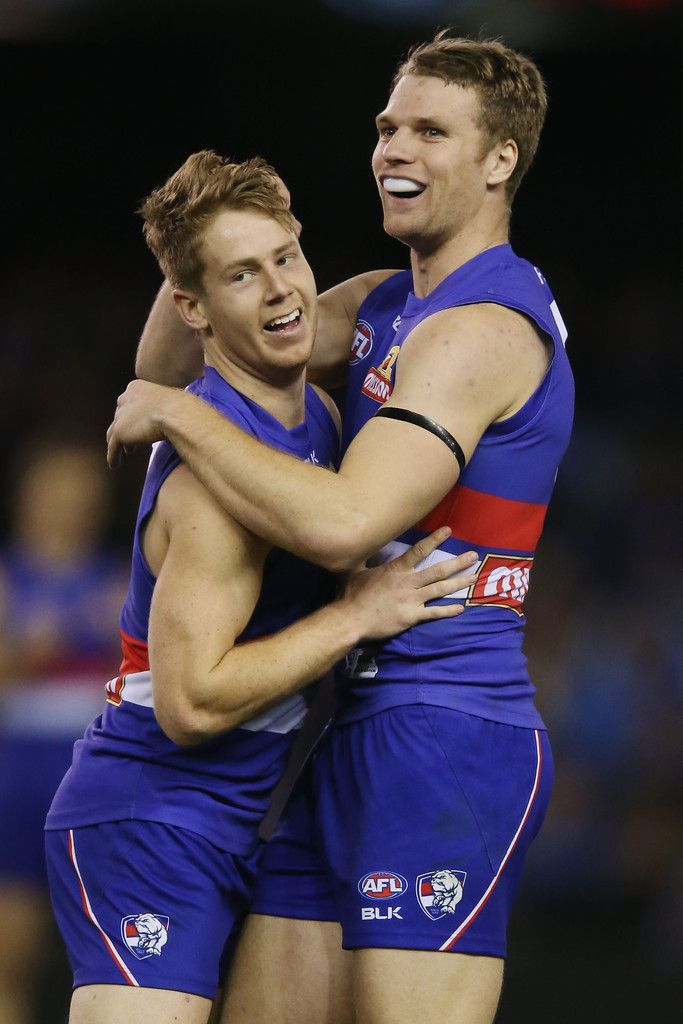 Jake Stringer and Lachie Hunter Photos - Lachie Hunter of the Bulldogs (L) celebrates a goal with Jake Stringer during the round 20 AFL match between the Western Bulldogs and Melbourne Demons at Etihad Stadium on August 16, 2015 in Melbourne, Australia. - AFL Rd 20 -  Western Bulldogs v Melbourne