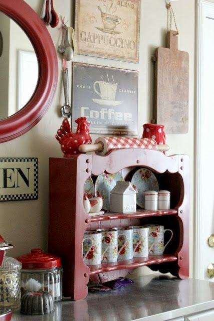 Just a pretty shelf for mugs. Big glass canisters for hot cocoa.