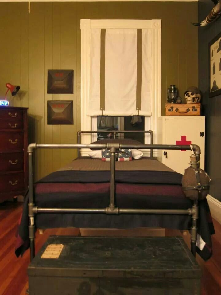 "My 8 year old Son's ""vintage military"" bedroom, we created. His Father designed and built the pipe bed."