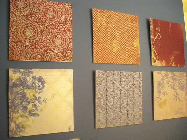 I've been using fancy wrapping paper to decorate for years now. It's a great way to add large swaths of color on a tight budget. You can decorate a large wall for less than 15 bucks...pretty paper also looks extra chic in funky picture frames.