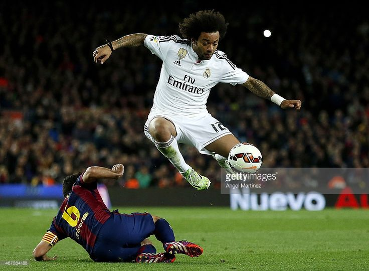 Marcelo Vieira of Real Madrid jumps over Xavi Hernandez of FC... News Photo | Getty Images