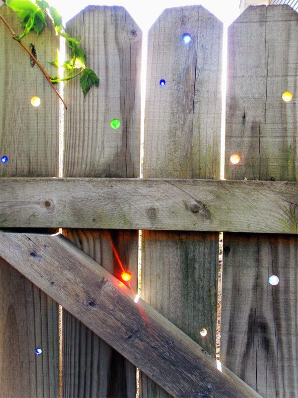 If I had a fence I would put marbles in the holes like this. So cool!: Marbles In Fence, Wood Fence, Gardens Fence, Idea, Marbles Fence, Old Fence, Glasses Marbles, Wooden Fence, Gardens Art