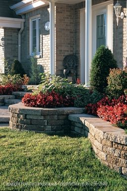 Raised planting beds with stacked stone walls: Poynter Landscape Architecture