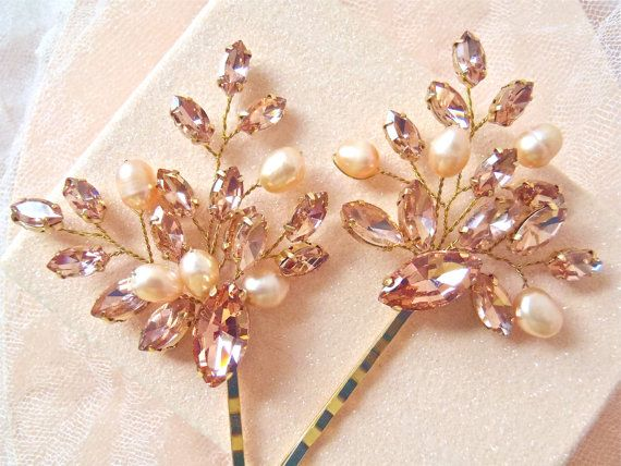 Blush coloured navette rhinestones in varying sizes , hand wired with gold tone wire and attached to a gold tone bobby pin. Blush pink freshwater