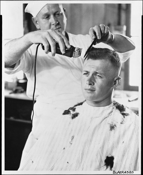 "Recruit Fred Roberts from Greenville, Tennessee, received his first ""G.I."" haircut in this World War II-era photograph, dated September 28, 1943. Roberts enlisted in the Navy's Seabees."