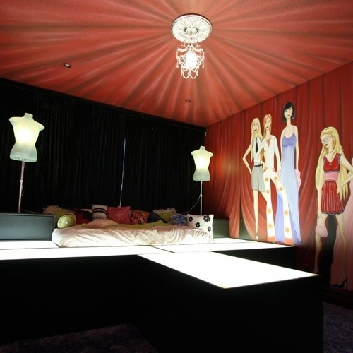 Fashion themed teen bedroom with underlit catwalk bed and dress form lamps