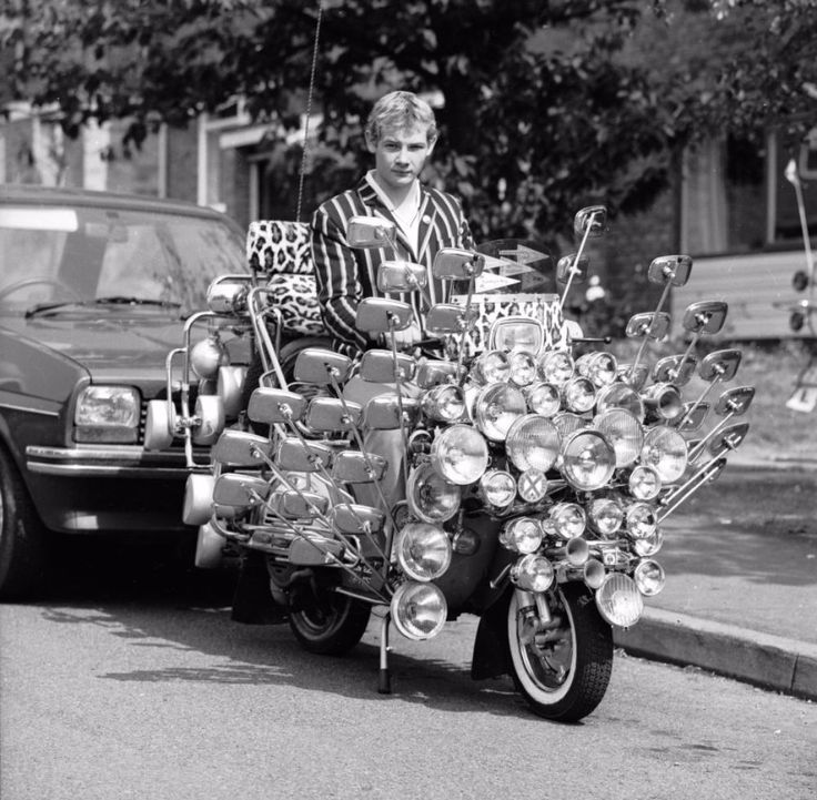 17-Year-Old School Leaver Showing Off His Customized Vespa Scooter, Which Has 34 Mirrors and 81 Lights