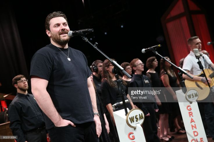 Lifting Lives music Campers join Singer-songwriter Chris Young on stage during a Performance at Grand Ole Opry House on June 27, 2017 in Nashville, Tennessee.
