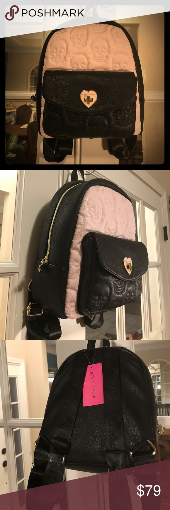 """🆕 Betsey Johnson's Medium Skull Backpack This Betsey Johnson's Medium Skull Backpack is black and light pink (blush colored.)   It is fully lined with Betsey Johnson fabric and has one zippered pocket and two slip pockets.  Straps are adjustable and have Betsey Johnson written on them. There is one front fully lined pocket, too. 💞. Roughly 10""""L x 12""""H x 5""""W (not including the front pocket.).   💋 Every gal needs a Betsey!💋 Betsey Johnson Bags Backpacks"""
