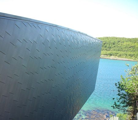 Norwegian architects Snøhetta completed Petter Dass Museum, a building cut into solid rock on a remote Fjord in Norway.