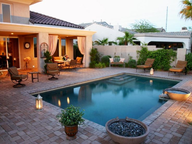 Pool And Patio Ideas design a pool deck or patio Small Tumbled Pavers Surround The Pool And Extend Throughout The Patio Area To Give This