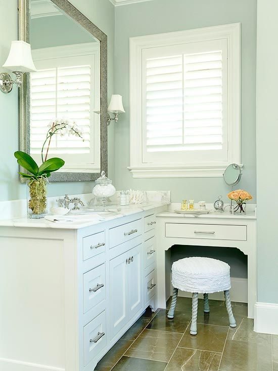 Crisply painted cabinetry sections the 12x15-foot room into task-specific areas for showering, soaking, drying off, dressing, grooming, and applying finishing touches: http://www.bhg.com/bathroom/storage/storage-solutions/ultimate-storage-packed-bathrooms/?socsrc=bhgpin031714nooksandcrannies&page=9